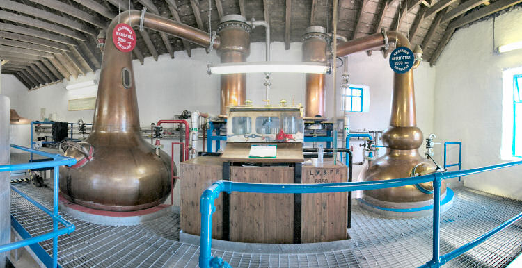 Picture of a panoramic view into the still house of a small farm distillery (Kilchoman distillery on Islay)