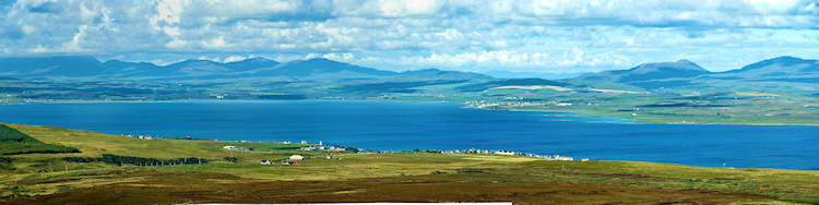 Picture of a panoramic view over a sea loch with two villages